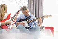 Father and daughter playing electric guitars at home Royalty Free Stock Photo