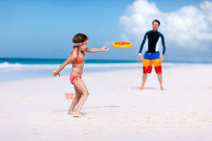 Father and daughter playing with flying disk royalty free stock images