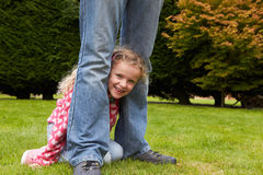 Father And Daughter Playing Game In Garden Together Stock Photos