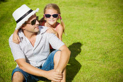 Father and daughter playing on the grass Stock Photos