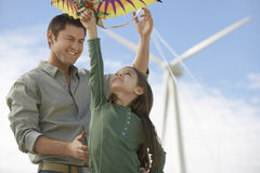 Father And Daughter Playing With Kite Stock Photography