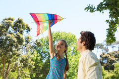 Father and daughter playing with kite Royalty Free Stock Photo