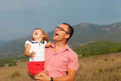 Father and daughter playing. In the mountains Royalty Free Stock Image
