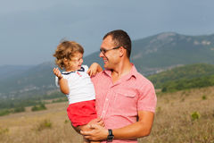 Father and daughter playing. In the mountains Royalty Free Stock Images