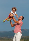 Father and daughter. Playing in the mountains Stock Images