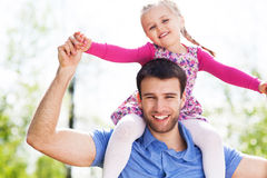Father and Daughter. Playing outdoors Stock Photography