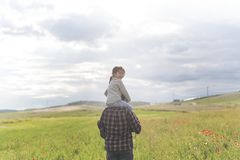 Father an little daughter walking stock images