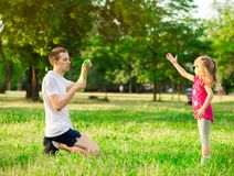 Father and daughter playing in the park at the day time. Concept of family. stock photo
