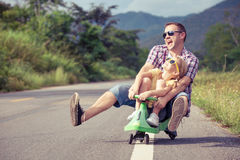 Father and daughter playing on the road. Stock Images