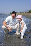 Father and Daughter playing in the sea Royalty Free Stock Images