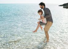 Father and daughter playing by the sea in Pula Croatia stock image