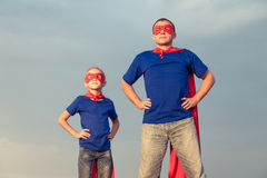 Father and daughter playing superhero at the day time. royalty free stock photo