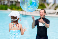 Father and daughter playing at swimming pool Royalty Free Stock Images