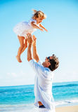 Father and daughter playing together at the beach Royalty Free Stock Photos