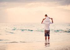 Father and Daughter Playing Together at the Beach at Sunset Stock Photography
