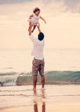 Father and Daughter Playing Together at the Beach at Sunset Royalty Free Stock Photo