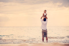 Father and Daughter Playing Together at the Beach at Sunset Royalty Free Stock Images