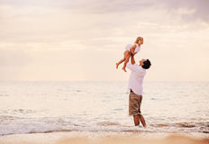 Father and Daughter Playing Together at the Beach at Sunset Stock Image