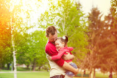 Father and daughter playing together in countryside. Stock Images