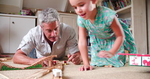 Father And Daughter Playing With Train Set In Bedroom stock video footage