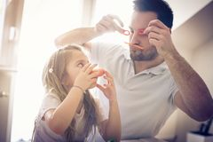 Funny face with vegetable. Father and daughter playing with vegetable royalty free stock photos