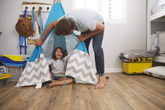 Father And Daughter Playing In Wigwam In Playroom Royalty Free Stock Image