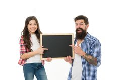 Father and daughter pointing at blank chalkboard. List things to do together. Child and father best friends. Parenthood. And childhood. Fathers day concept royalty free stock photos