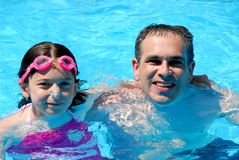 Father daughter pool. Father and daughter having fun in a swimming pool Stock Photography