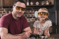 Father and daughter posing while brazing. At home royalty free stock image