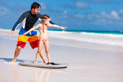 Father and daughter practicing surfing Stock Photo