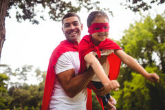 Father and daughter pretending to be a superhero Stock Photography