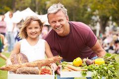 Father And Daughter With Produce From Outdoor Farmers Market Royalty Free Stock Photography