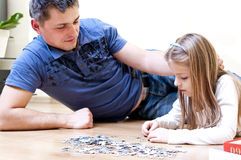 Father daughter puzzle Royalty Free Stock Photos