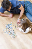 Father and daughter puzzle Stock Photos