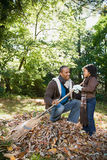 Father and daughter raking leaves Royalty Free Stock Photo
