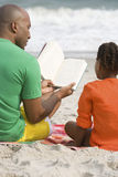 Father and daughter reading a book Stock Image