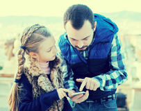 Father and daughter reading guide Stock Photography