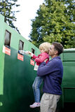 A father and daughter recycling plastic bottles Stock Photo