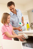 Father And Daughter Recyling Waste Stock Images