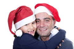 Father and daughter with  red caps Santa Claus Royalty Free Stock Images