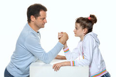Father and daughter relations wrestling in studio. Father and daughter relations - wrestling in studio - two people on white background Stock Photos
