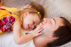 Father and daughter relaxing in hammock Royalty Free Stock Photo