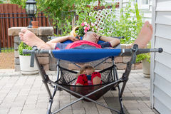 Father and daughter relaxing together on the patio Royalty Free Stock Photography