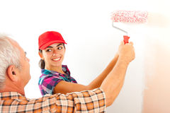 Father and daughter renovating home Stock Image