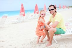 Father and daughter at resort beach Stock Images