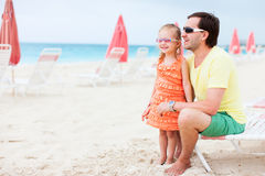 Father and daughter at resort beach Stock Photos