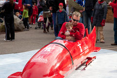 Father and daughter riding relpica bobsleigh, Winter Olympics Stock Photo