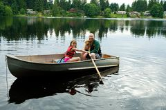 Father and Daughter in Rowboat Stock Image