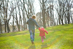 Father and daughter running Stock Photo