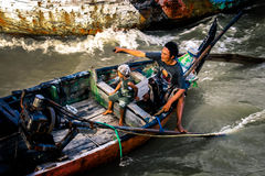 Father and Daughter. Sailor family in their boat at Demak Central Java Indonesia royalty free stock photo